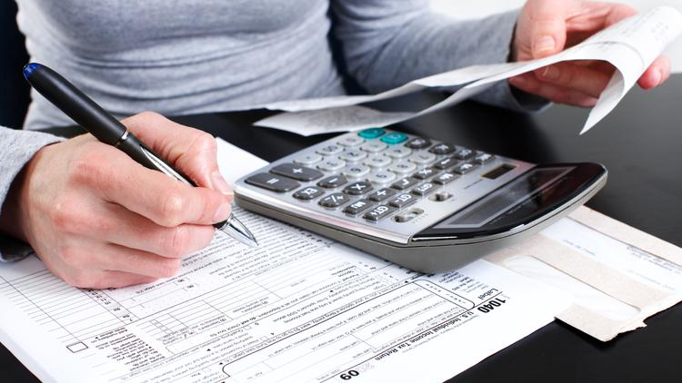 Person filling out tax information